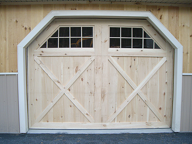 Custom built wooden barn doors quality amish built for Swing out garage doors price