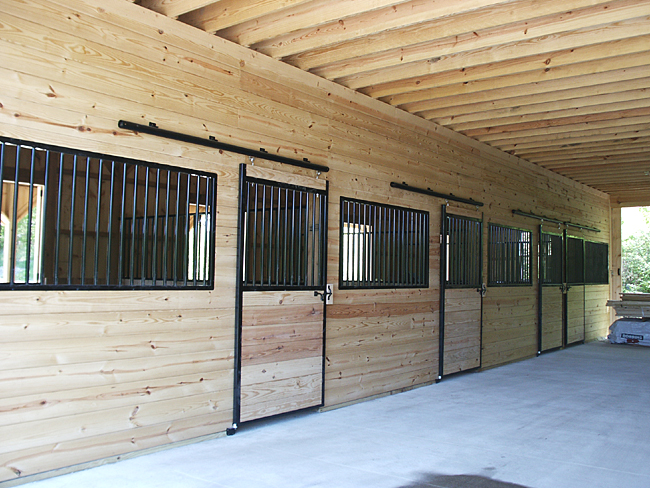 Stable stall fronts and center aisle for Horse stall door plans